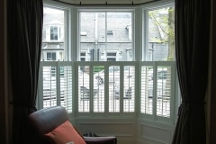 White Half Height Café Style Shutters on a Bay Window