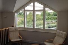 White Shutters in a Coombed Ceiling Bedroom