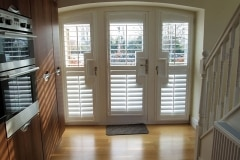 Arched Top French Door Window Shutters in White in Kitchen