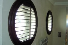 Circular Window Shutters in a Bathroom
