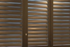 Portchester Security Shutters  with 89mm louvres and finished in Charcoal
