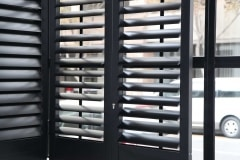 Aluminium Security Shutters  with 89mm louvres and finished in Charcoal