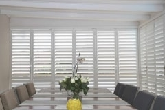 Satin White Portchester Security Shutters in a Dining Room