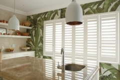 Satin White Six Panel, Tracked Security Shutters  in a Kitchen