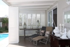 External Satin White Portchester Security Shutters in a Sun Lounge