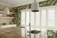 Satin White Portchester Security Shutters in a Kitchen