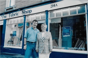 June & David Browne outside The Fabric Shop at 214 Perth Road, Dundee