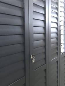 Portchester Security Shutters on a Patio Door in Charcoal from The Scottish Shutter Company