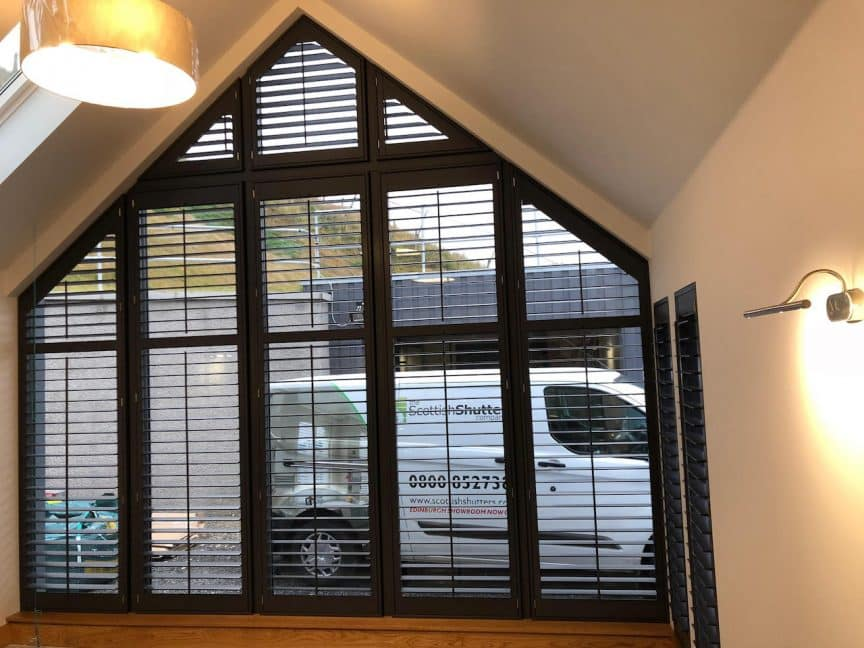 Inside view of a trapezoidal gable with newly applied custom shutters